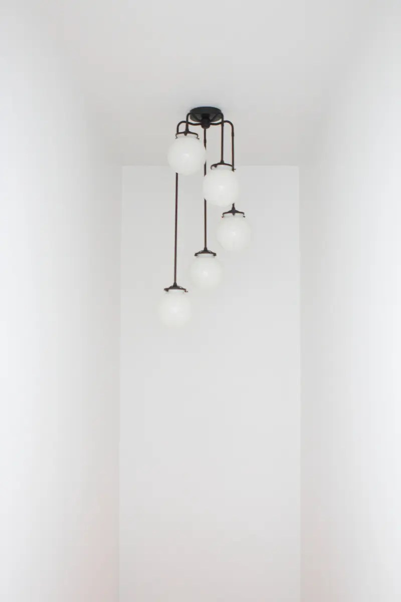 a new light fixture in the stairwell