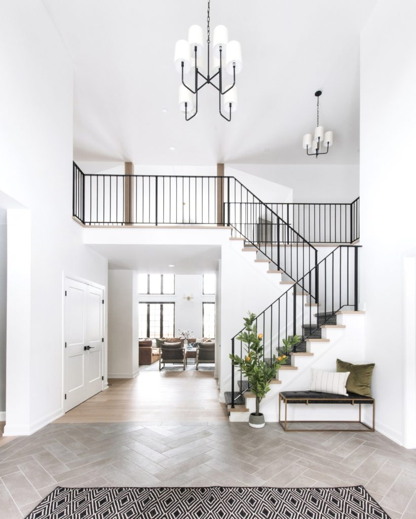 Metal Stair Railings Makeover Inspiration The Diy Playbook | Black Metal Handrail For Stairs | Rod Iron | Metal Railing | Iron Pipe | Natural Wood | Artistic