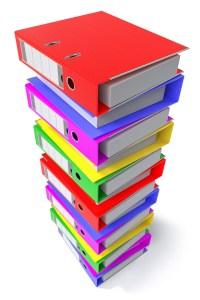 A stack of colorful loose-leaf binders.