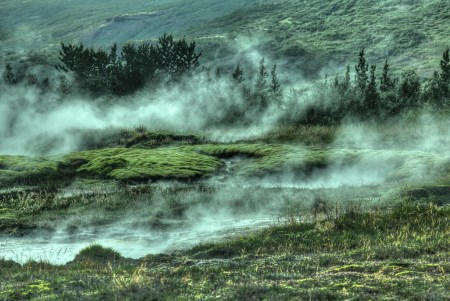 Example of a spectacular Icelandic green landscape at the Strokkur geyser, Selfoss.