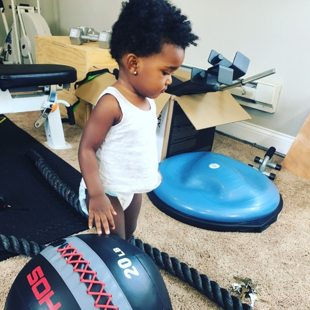 baby looking at equipment for high-intensity interval training