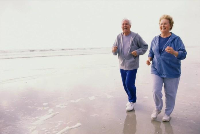 seniors exercising on beach 2048 x 1370