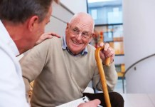 Doctor & elderly patient with cane 849 x 565 px