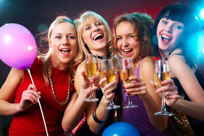 Young women partying with champagne 1500 x 1007