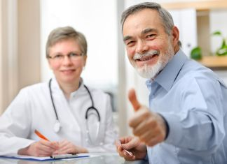 happy senior patient and doctor at the doctor's office 848 x 565