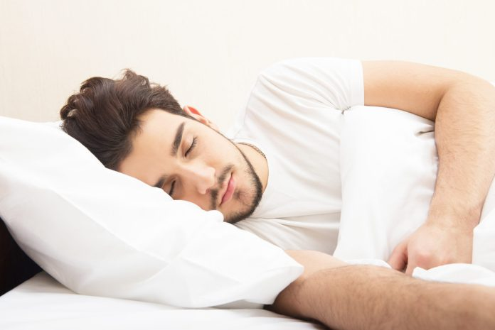 young man sleeping in bed 2048 x 1367
