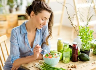 Young woman at sunny table eating healthy food 2048 x 1367