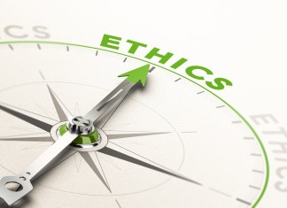 compass with needle pointing the word ethics. 1500 x 992
