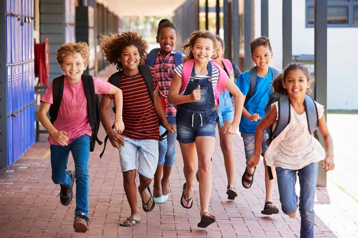 School kids running in elementary school hallway 1500 x 1000