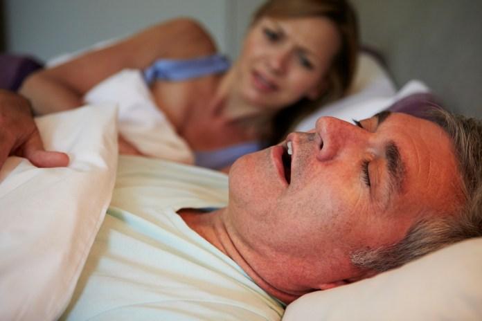 Man Keeping Woman Awake In Bed With Snoring 2000 x 1333