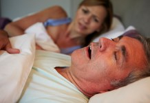 Man Keeping Woman Awake In Bed With Snoring 2000 x 1333