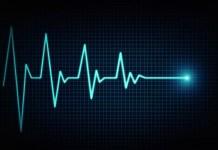 Neon blue EKG on black background 2116 x 1417