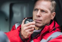 Paramedic talking on radio closeup 1500 x 1123