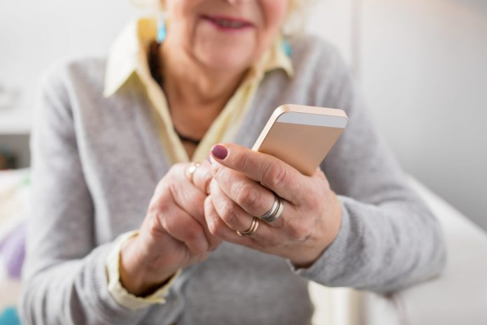 Senior woman looking at cell phone 2121 x 1414