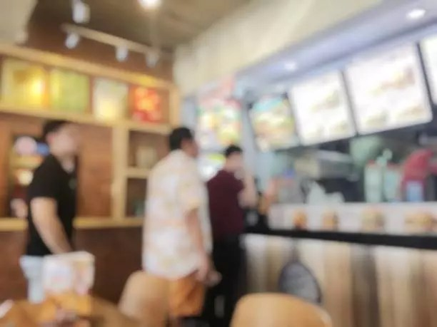 blurred image of people standing in line in fast food restaurant (612 x 459)