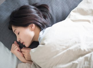 Young Asian woman sleeping 1500 x 1000
