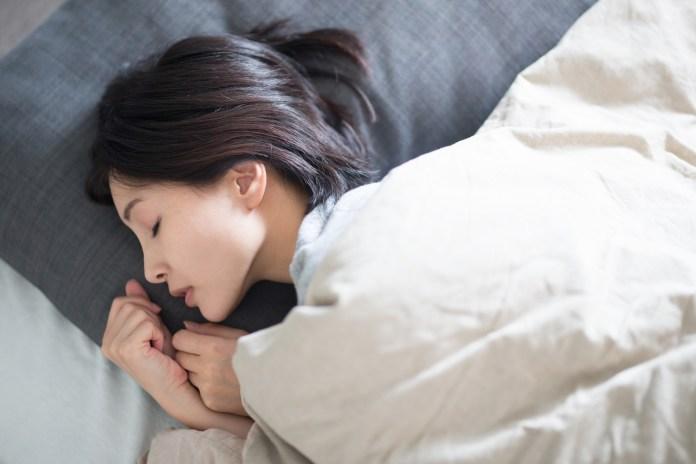 Young Asian woman sleeping 1500 x 1000