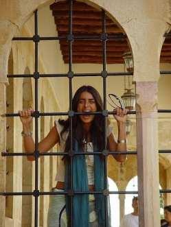 girl behind bars