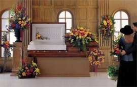 casket and flowers