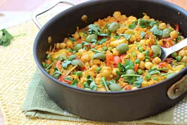 Chickpea paella with artichoke hearts, bell pepper, and tomatoes