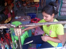 This woman takes about 30 minutes to hand make each bracelet.