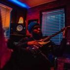 playing guitar orange blue