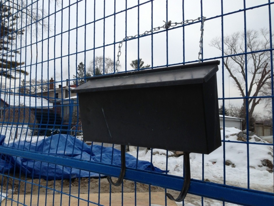 Our lonely mailbox attached to the outside of the construction fence.