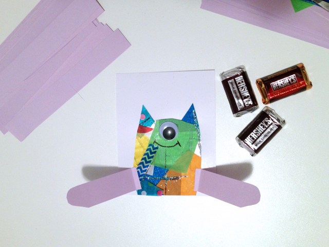 Cardstock arms hold the chocolate | One-eyed monster no-heart Valentine craft