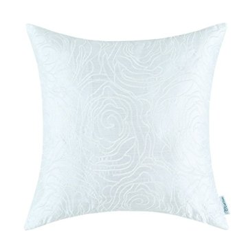 White embroidered accent pillow