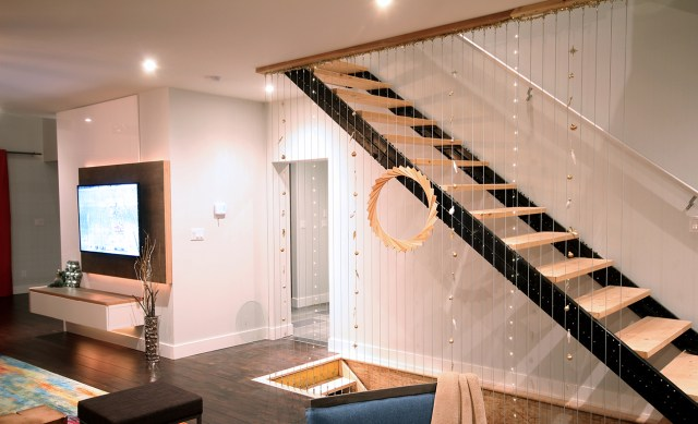 Dreamhouse Project modern industrial stairs decorated with ornament garlands & wooden wreath