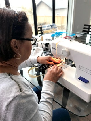 Mom getting the sewing started