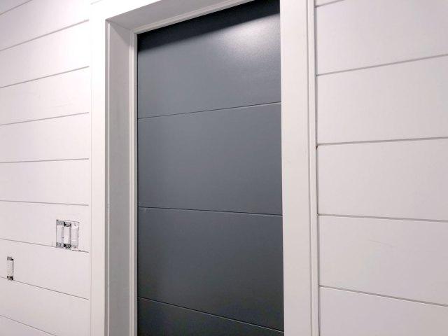 Metrie Option M modern shiplap installed along the door wall