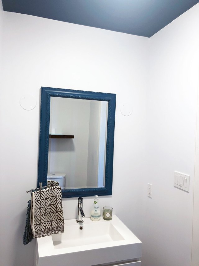 The powder room before - Vanity wall with view of painted ceiling