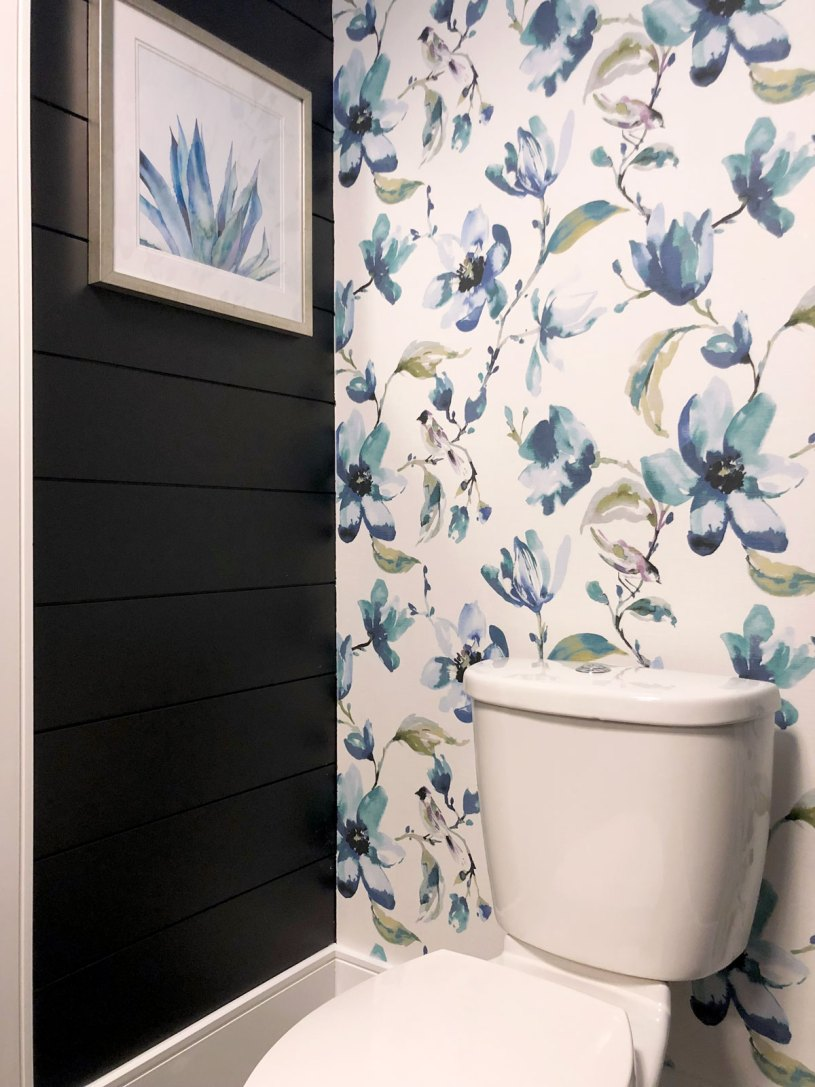 The DIY fabric wallpaper feature is a lovely contrast to the dark shiplap walls