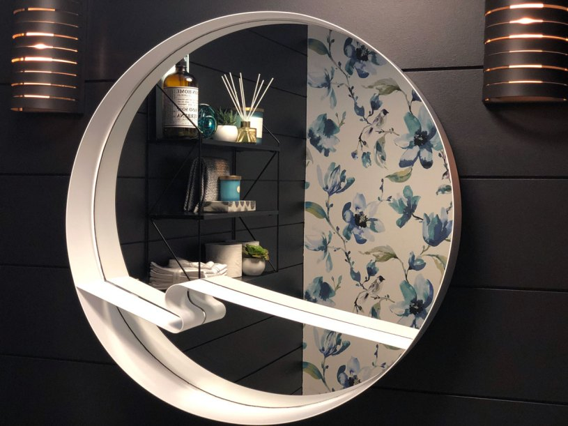 The round mirror is a perfect choice to soften the straight lines of the shiplap and the contrasting white colour helps it to pop against the dark walls