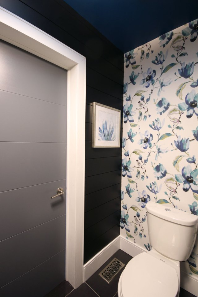 Love how our DIY fabric wallpaper contrasts beautifully against our black shiplap walls & modern door; both from Metrie