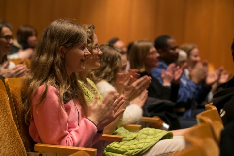 Audience members join in at the lecture.