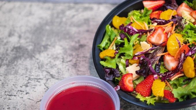 Mandarin & Strawberry Salad with Raspberry Vinaigrette presented in their to go containers