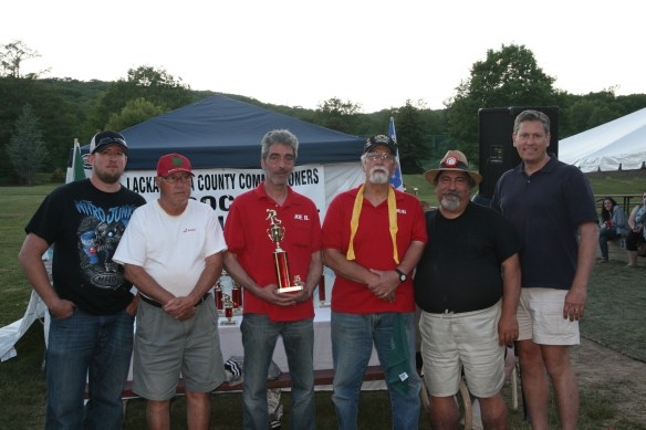 The members of Bullshead 3 accept their third place trophies from the organizers of the tournament.  From left are Mike Ancherani, Lou Nardella, Joe Bonacuse and Doug Simone of Bullshead 3; John Rettura, tournament director; and William Davis, the deputy director of the county's Parks & Recreation Department.