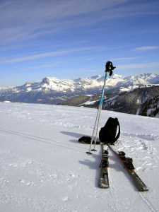 skis and poles on mountaintop
