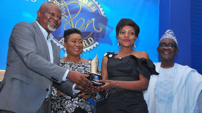 Sales Director, Nigeria Breweries, Plc., Uche Unigwe (left); foremost female public relations practitioner, Mrs. Nkechi Ali Balogun; The Guardian's photojournalist, Lucy Ladidi Elukpo, and Dr. Henry Odukomaiya during the presentation of the second-runner plaque in the Photojournalist of the Year category to Elukpo at the 2018 Nigerian Breweries Golden Pen Awards in Lagos… at weekend. PHOTO: AYODELE ADENIRAN