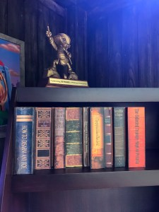 Scrooge McDuck's bookcase at Donald's Dino-Bash