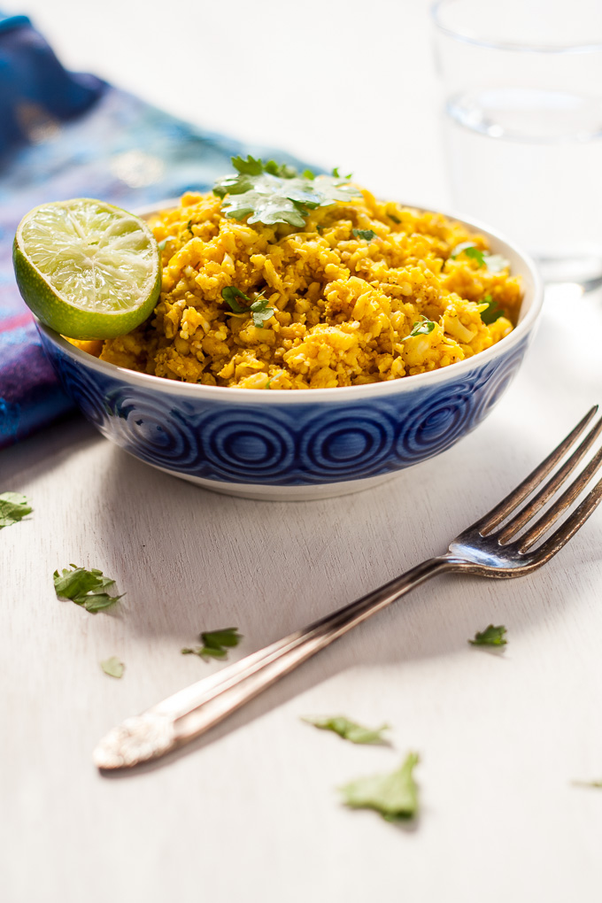 Indian spiced cauliflower rice is super easy and only takes 10 minutes to make, all the indian spices and its suitable for vegans to