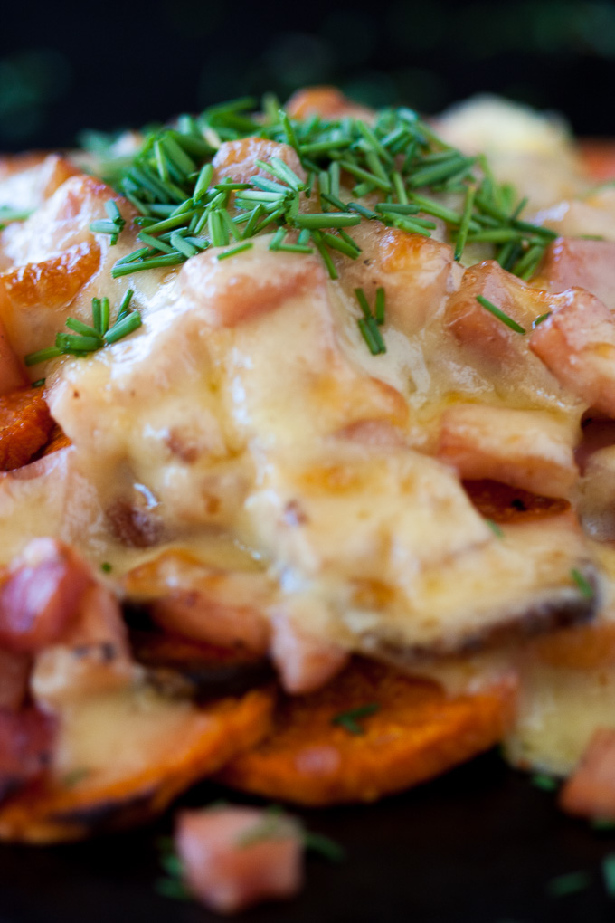 An easy tasty snack. lunch or side with melted cheese, bacon and chives.