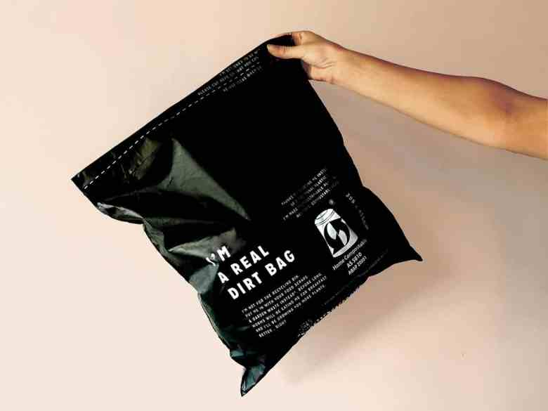 Hand-holding-comPOST-sustainable-packaging
