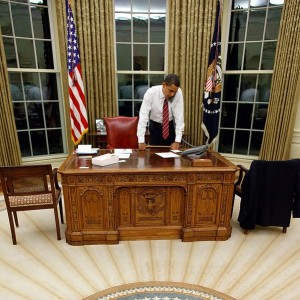 Barack Obama behind Resolute Desk in the Oval Office - Public Domain