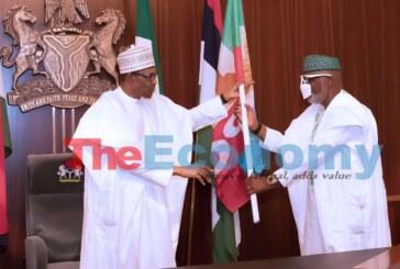 President Muhammadu Buhari presents APC Party flag to Ondo Incumbent  Governor and Gubernatorial Candidate,  Rotimi Akeredolu