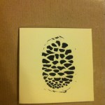 handmade handprinted mini christmas cards black pine cone design