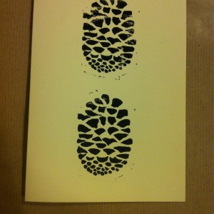 handprinted handmade christmas card pine cone fir cone design in black