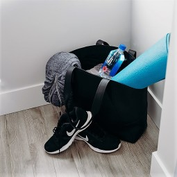"Even a home gym needs a gym bag: I always keep my Yoga bag packed to grab easy if I am heading to a ""real"" class. This room is off my laundry room so when I come back in I throw clean stuff in and dirty stuff up. It actually never goes upstairs!"